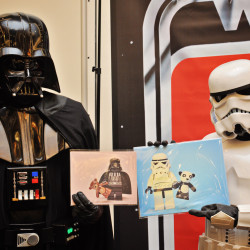 Darth Vader and Stormtrooper cosplayers pose with Star Wars photographs by Jodi Renshaw at the 2015 Bangor Comic & Toy Con, held in April.