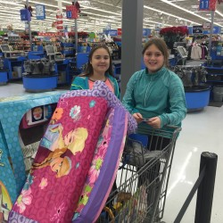Kailee Soucia of Orrington (right) and her friend, Olivia Healy, also of Orrington, bought presents for children on the Angel Tree at the Brewer Walmart, in lieu of Kailee receiving her own presents for her December birthday.