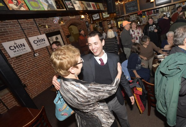 Ben Chin hugs his stepmother, Linda Milosky of Syracuse, New York, after losing the run-off election for Lewiston mayor to incumbent Robert Macdonald Tuesday.