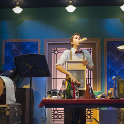 """Luke Cote is the on-stage foley artist for the live radio play adaptation of """"It's a Wonderful Life"""" at Penobscot Theatre. Photo by Magnus Stark."""