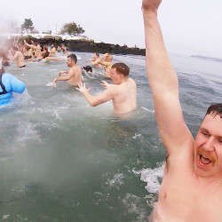 Dozens celebrate New Year with frosty dip at Acadia
