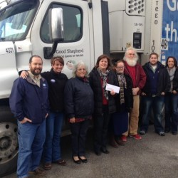 Representatives from area credit unions pose for a picture in front of one of Good Shepherd Food Bank's Food Trucks, with representatives from several Bangor area food pantries and the Good Shepherd Food Bank.  The Maine CU representatives were joined by the Maine Credit Union League in representing the Maine CUs' Campaign for Ending Hunger in making a $7,500 contribution to support the 'Food Mobile' program and help area food pantries provide holiday meals.  Collectively, the contribution will provide more than 30,000 meals.