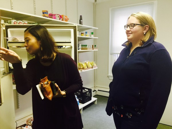 Maisarah Miskoon and Tabatha Copeland, past and current directors of Southern Maine Community College survey their food supply at The Captain's Cupboard, a student-led food pantry.