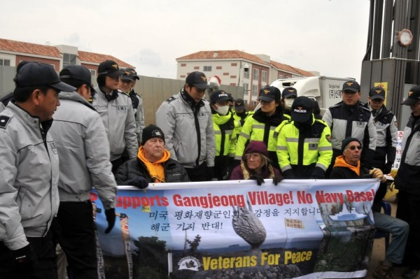 Members of the U.S. group Veterans for Peace block construction vehicles at the Gangjeong Village Navy base gate in South Korea in protest of the construction of a U.S. Navy base in December 2015.