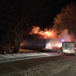 Fire damages Dexter home, destroys camper, shed
