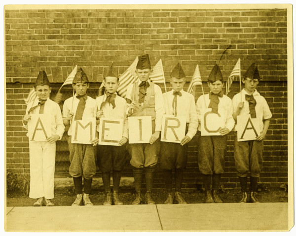 Students at Portland's Chapman School line up for a patriotic demonstration circa 1920. The students were probably part of an Americanization class in which immigrants or children of immigrants were taught about American civic life, American culture, and English.