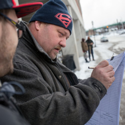 "David McKenzie, 40, of Bangor signs a petition outside the garage at Pickering Square in Bangor on Wednesday for a 2016 referendum question to allow a casino in York County. ""I think it's a good idea,"" he said. ""It brings in money. And — I don't know how else to say this — I like gambling."""