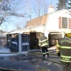 Officer pulls woman from burning home in Waldoboro