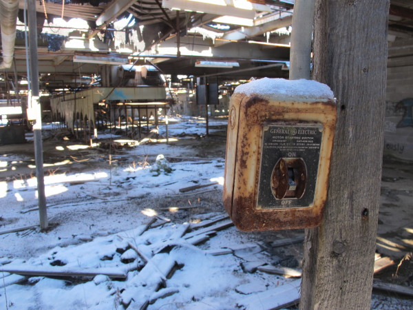 An old switchbox sits mounted on a pole at a defunct tannery off Route 1 in Hancock. Town officials are applying for $400,000 in federal brownfields grant money to help clean up 14 acres of the 150-acre property, including the decrepit building.