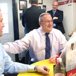 Maine Gov. Paul LePage, center, made a full-on sales pitch for consolidating Lewiston and Auburn into one city during a lunchtime meeting with the mayors of both cities Wednesday at Simones' Hot Dog Stand. LePage met with Auburn Mayor Jonathan LaBonte, left and Lewiston Mayor Robert Macdonald, right.