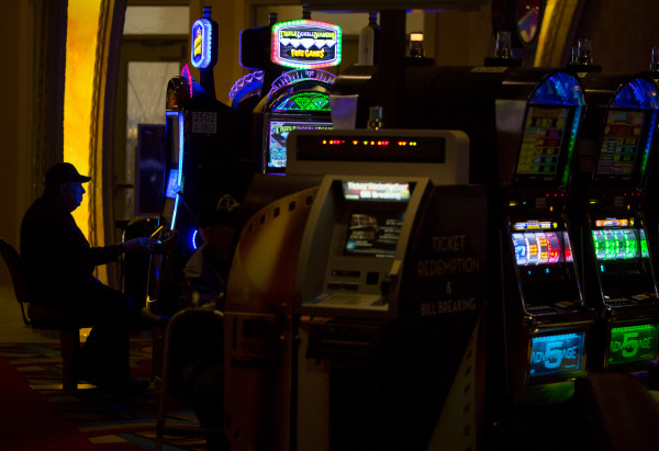People play slots at Hollywood Casino in Bangor Friday.