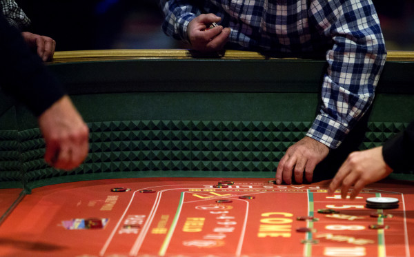 People place their bets at Hollywood Casino in Bangor Friday.