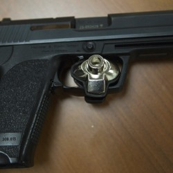 A trigger lock is placed on a gun seen June 25, 2014, at the Bangor barracks of the Maine State Police.