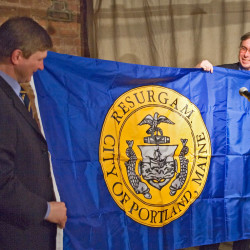 Portland City Councilor Ed Suslovic, right, presents the Portland city flag to a representative of the Russian sister city of Arkhangelsk in this 2007 photo posted by the city's Archangel Committee.
