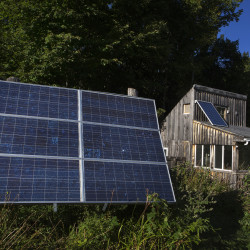 Solar panels are seen on the outside of Erica Buswell and Scott Giroux's simple home on Sept. 14, 2015, in Searsport. They live in a simple, old-fashioned way on their piece of land in Searsport where Giroux has built all the structures on the property.