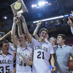 George Stevens Academy celebrates after defeating Bucksport during their Class C North boys championship basketball game on Feb. 19 at the Cross Insurance Center in Bangor.