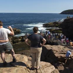 People enjoy Thunder Hole at Acadia National Park Friday.