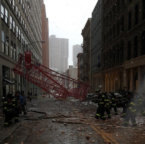 Emergency crews survey a massive construction crane collapse on a street in downtown Manhattan in New York, in a picture released by the New York City Police Department, Feb. 5, 2016.