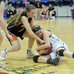 Shead's Brooke Robbinson tries to wrestle the ball away from Rangeley's Natasha Haley in the first half of the Class D state championship game Saturday at the Augusta Civic Center. The Lakers topped the Tigers 28-22.
