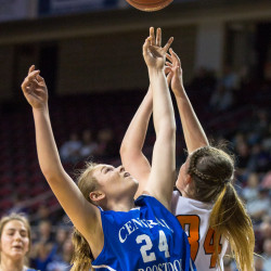 Central Aroostook's Ashlee Harris (center) tries to catch a rebound against Shead's Katelyn Mitchell (right) during the Class D North girls basketball championship at the Cross Insurance Center in Bangor on Saturday. Shead won the game 44-37.