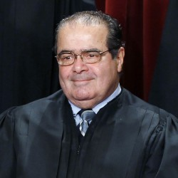 U.S. Supreme Court Justice Antonin Scalia poses for a group portrait in the East Conference Room at the Supreme Court Building in Washington, D.C, in 2010.