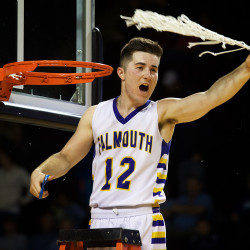 Falmouth High School's Colin Coyne celebrates his team's victory in the Class A boys state championship game in Portland on Saturday.