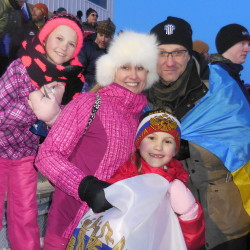 Anna Titova and Andriy Smuk brought their daughters Daria, 11, and Alexandra, 6, from Rhode Island to Presque Isle from Feb. 11-13 to see biathlon races they had only watched on television before. Andriy wears the flag of his native Ukraine and Alexandra's hat and flag bear Russian emblems of her mother's home.