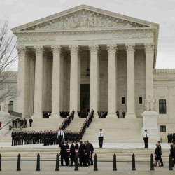 The casket of late U.S. Supreme Court Justice Antonin Scalia is carried into the U.S. Supreme Court by pallbearers, where Scalia's body will lie in repose in the court's Great Hall in Washington, Feb. 19, 2016, a day before his funeral service. Scalia died Feb. 13, 2016, at the age of 79.