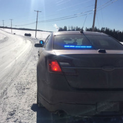 Snowplow overturns on sharp corner in Perham