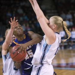 Albany's Shereesha Richards (center) drives for the basket between the University of Maine's Mikaela Gustafsson (right) and Liz Wood during on Feb. 14 at the Cross Insurance Center in Bangor. Wood and Gustafsson are two of eight UMaine seniors who will play their final regular season game Saturday in Bangor.