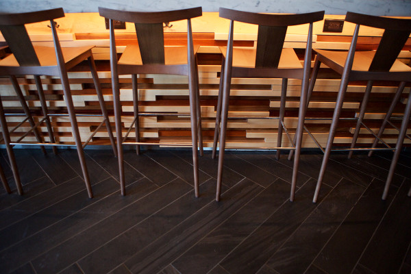 Sleek wooden barstools meet the geometric patters below the bar and on the floor at UNION, the Press Hotel's restaurant in Portland. UNION is one of the city's many eateries setting itself apart not only by its cuisine but by its design as well.
