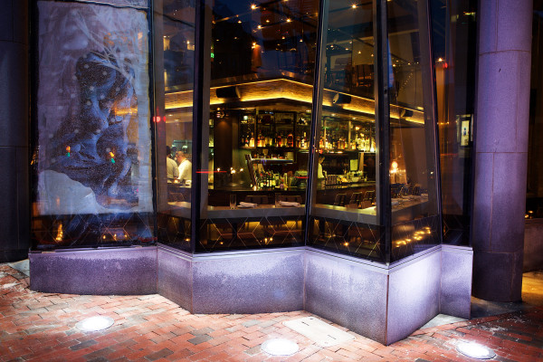 Large, angular glass panes give pedestrians a view inside EVO Restaurant + Bar on Fore Street in Portland. EVO is one of the city's many eateries setting itself apart not only by its cuisine but by its design as well.