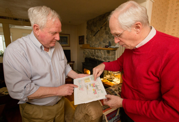 Glen Rea and Al Faust, president of the Maine Chapter of the American Chestnut Foundation, look over files on where American chestnut trees have been planted at Rea's home in Bangor on Thursday. The two have been working within the foundation breeding blight resistance from the Chinese chestnut tree into the American chestnut, while keeping the American tree's characteristics.