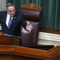 Gov. Paul LePage addresses the chamber during the 2015 State of the State address.