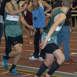 Old Town's Austin Robichaud, left, hands the baton to teammate Connor Poirier during the boys 4 x 800-meter relay at the State Class B Indoor Track and Field Championships at Bates College in Lewiston on Saturday.