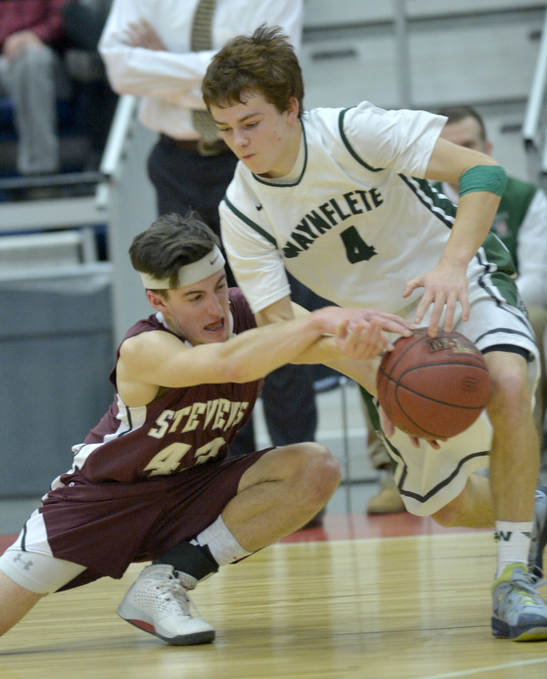 George Stevens Academy's Jarrod Chase attempts to get the ball away from Waynflete's Will Nelligan in the first half of the Class C state championship Saturday night at the Augusta Civic Center. Nelligan retained control of the ball.