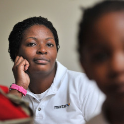 Marquita Shealey, left, and her 4-year-old daughter Gabriel Blount pose for portrait at their Lithonia, Georgia home, September 11, 2012. Shealey is considering pulling her daughter out of private school because of the financial constraints of an upside-down mortgage combined with home repairs.