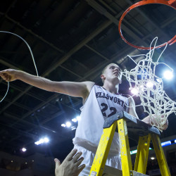 Ellsworth's Nicholas Bagley takes down the net after the Eagles defeated Orono 52-34 for the Class B North championship Saturday at the Cross Insurance Center in Bangor.