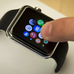 A customer touches the screen on the new Apple Watch displayed at an Apple Store in New York April 10, 2015.