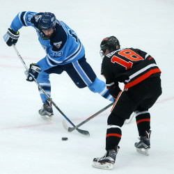 Nolan Vesey (left) of the University of Maine, pictured during a game in November 2015, scored the team's only goal in a 7-1 Hockey East loss to Northeastern on Saturday night.
