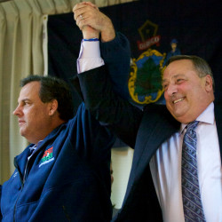 New Jersey Gov. Chris Christie raises Gov. Paul LePage's hand at a Republican rally in Portland in November 2014.