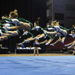 Old Town cheerleaders leap into the air during the Class B regional cheering championships Jan. 23 at the Cross Insurance Center in Bangor.
