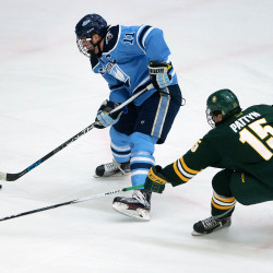 University of Maine's Steven Swavely (left) moves the puck around University of Vermont's Yvan Pattyn during their hockey game on Nov. 20, 2015, at Alfond Arena in Orono.