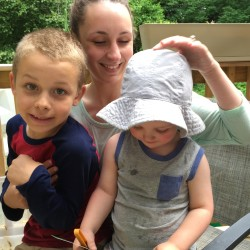 Marisa Nadeau and her two youngest boys, James (left) and Joshua, who were diagnosed with lead poisoning from their home in Hallowell.