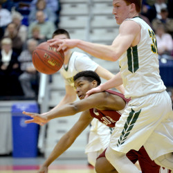 Jeffrey Spekhardt gets tripped as he fights with Oxford Hills' Andrew Fleming over the ball in the first half of their quarterfinal game in Augusta on Thursday.