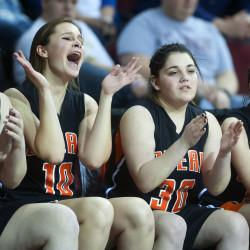Shead players cheer on their team as time expires and they defeat Washburn in their Class D North girls semifinal basketball game at the Cross Insurance Center in Bangor on Thursday.