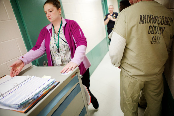 Desiree Fischer, a med tech at the Androscoggin County Jail in Auburn, wheels a medication cart down the hall on Wednesday. Between 30 and 61 percent of Maine's 1,774 county jail inmates were prescribed at least one psychiatric medication, according to a survey conducted by the Bangor Daily News in August.