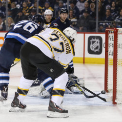 Bruins beat Senators, but lose Bergeron