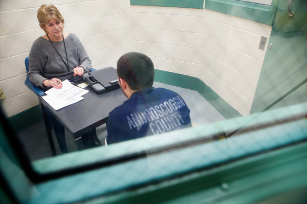Social worker Lynn Tijssen talks with a prisoner serving three months  at the Androscoggin County Jail on Wednesday in Auburn. Tijssen has worked in prison facilities for 18 years. The jail's only psychiatrist appears by teleconference one hour per week.