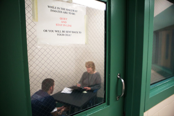Social worker Lynn Tijssen talks with a prisoner serving three months at the Androscoggin County Jail in Auburn on Wednesday. Tijssen works three days a week and the jail's only psychiatrist appears by teleconference one hour per week.